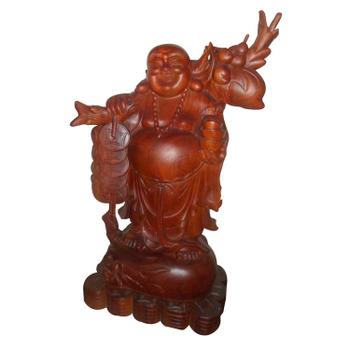 Tượng phật Di Lặc gổng cành đào, được làm từ gỗ hương